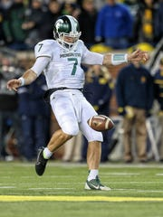 Michigan State backup quarterback Tyler O'Connor punts
