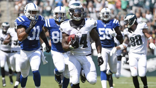 The Eagles' Kenjon Barner scores on a 94-yard punt return for a touchdown against the Colts in a preseason game on Sunday, August 16, 2015 in Philadelphia.
