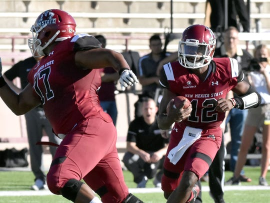 Offensive lineman Isaac McClain leads the way for quarterback