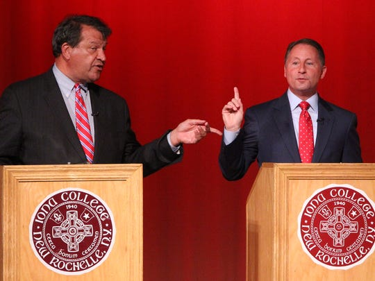George Latimer, left, and Westchester County Executive Rob Astorino debate at Iona College in New Rochelle Oct. 24, 2017.