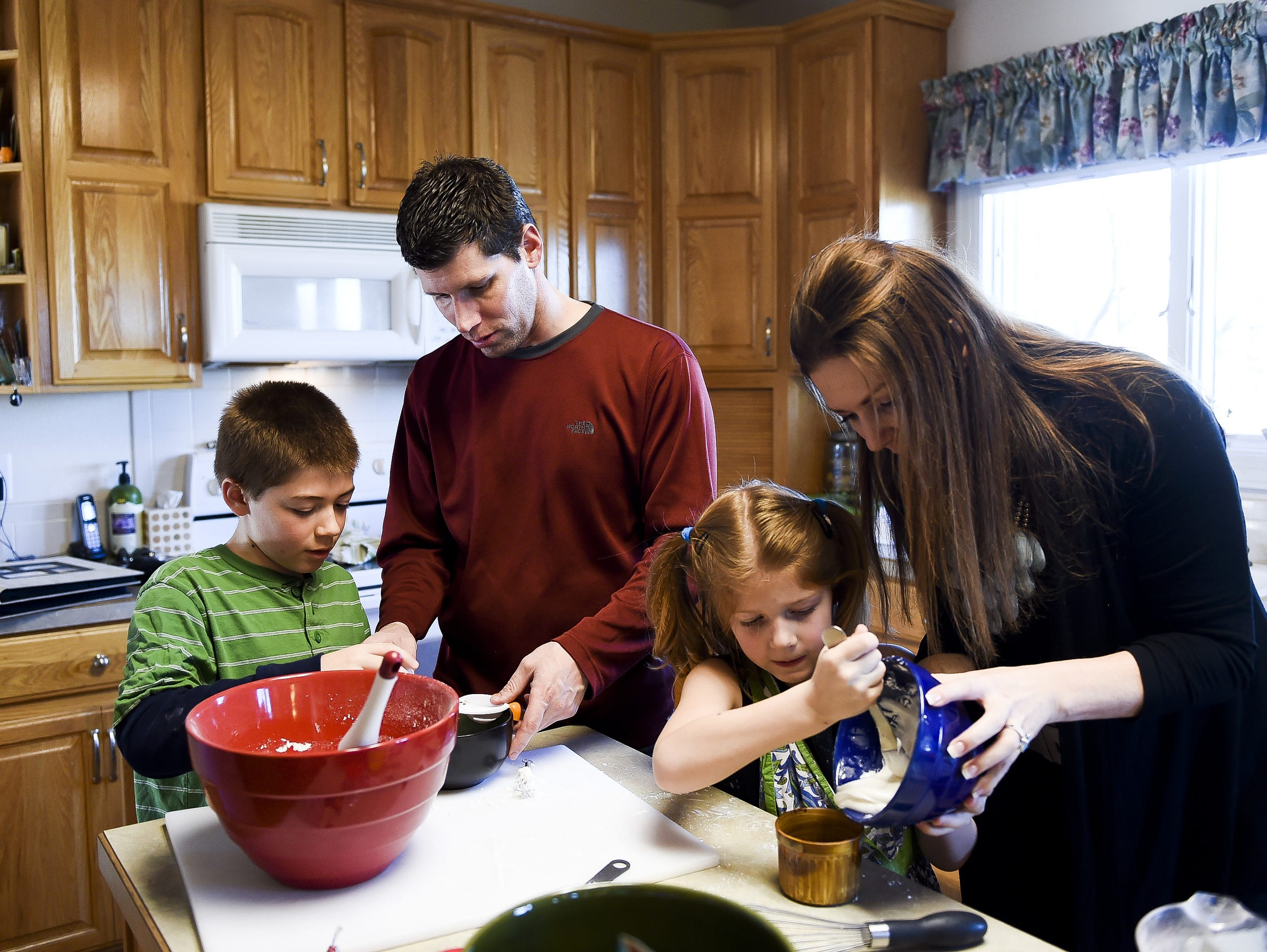 Jeff Wicks makes cookies with his two children Bryce