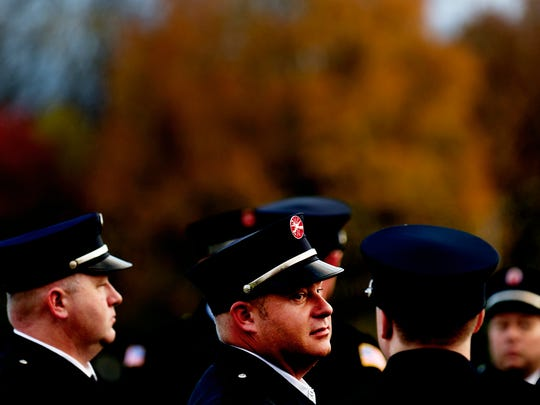 Pigeon Forge firefighters wait to take the stage during an event honoring first responders on one year anniversary of the Gatlinburg fires at Patriot Park in Pigeon Forge, Tennessee on Tuesday, November 7, 2017.