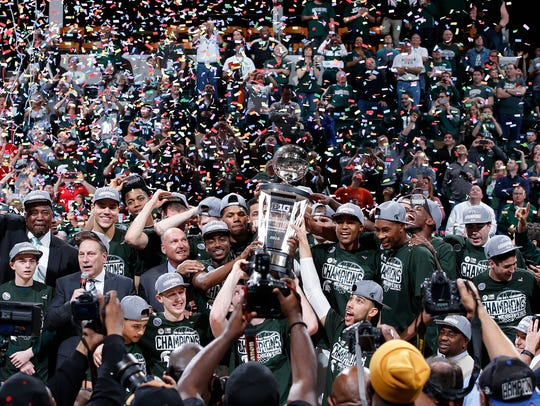 The Michigan State Spartans celebrate after defeating