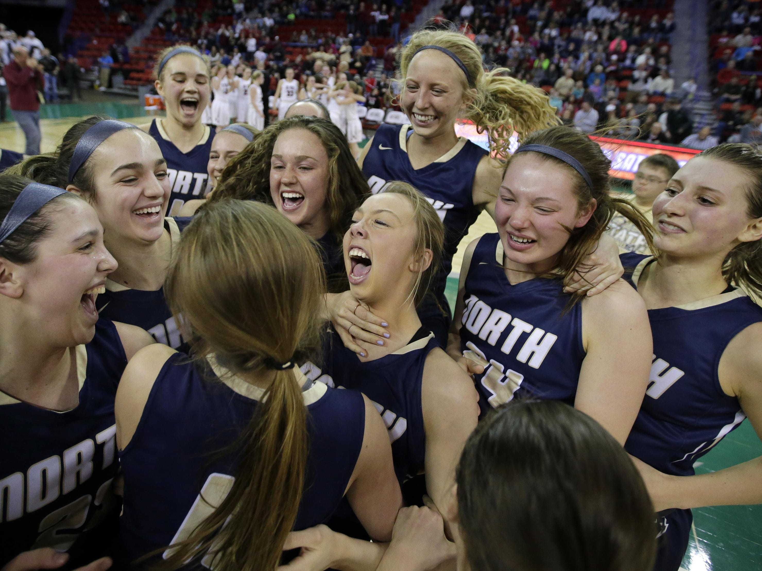 Appleton North players celebrate their victory against De Pere in the WIAA Division 1 girls' basketball state championship game Saturday at the Resch Center in Ashwaubenon. It is the first state title for North, which finished the season undefeated.