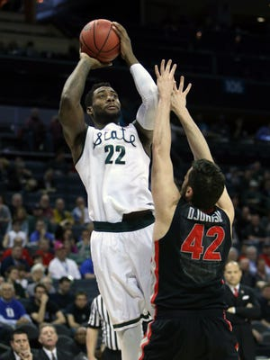 Michigan State's Branden Dawson against the Georgia Bulldogs' Nemanja Djurisic during first-half action of their second-round NCAA tournament game March 20, 2015 in Charlotte.