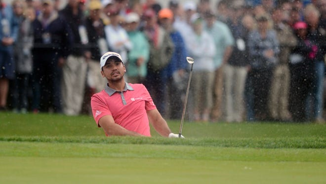 Jason Day watches to see where his ball lands after chipping from a bunker on the 9th hole during the second round Friday of the RBC Heritage golf tournament in Hilton Head Island, S.C.