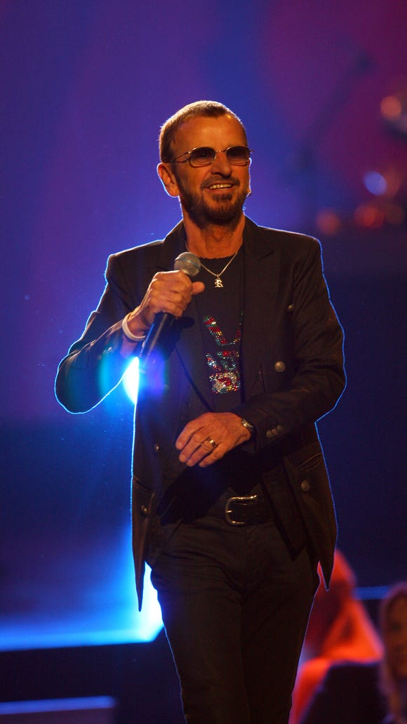 Ringo Starr performs at The Night That Changed America: a Grammy Salute to the Beatles, on Monday, Jan. 27, 2014, in Los Angeles.