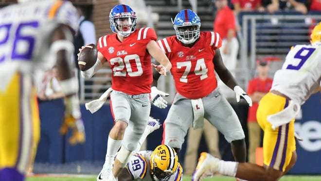 Ole Miss quarterback Shea Patterson (20) moves out of the pocket against the LSU Tigers during the second quarter at Vaught-Hemingway Stadium. Mandatory Credit: Matt Bush-USA TODAY Sports