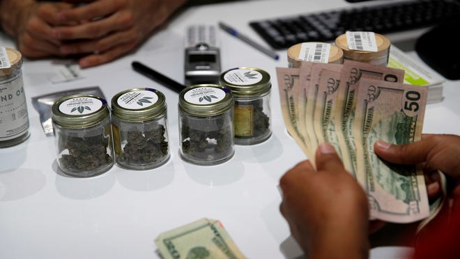 A person buys marijuana at the Essence cannabis dispensary in Las Vegas.