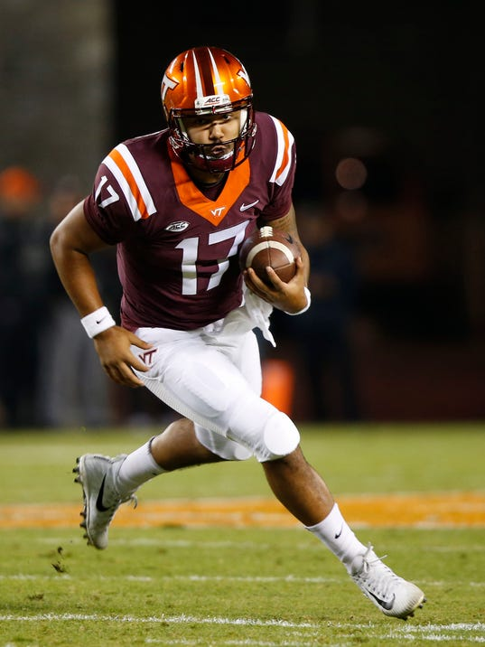 This Oct. 28, 2017 photo shows Virginia Tech quarterback Josh Jackson (17) running downfield during the first half of an NCAA college football game in Blacksburg, Va. Back-to-back losses have taken Virginia Tech out of contention for the ACC's Coastal Division championship, but Jackson says the team still has a lot of motivation to finish strong. Win their last three, he said, and it will be another 10-win season. (AP Photo/Steve Helber)