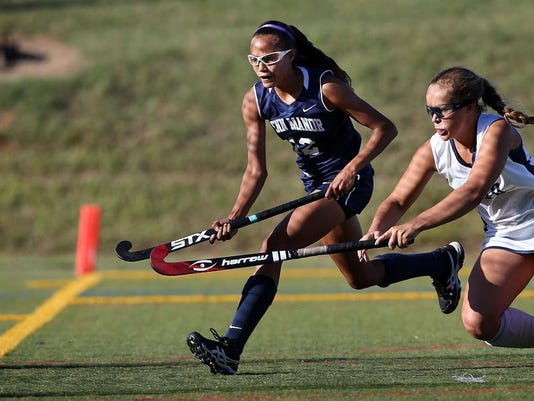 Penn Manor's Alyssa Schriver (12) scores on Manheim Twp.'s Olivia Witmer (20) during second half action at Manheim Twp. High School in Neffsville Monday September 14, 2015. Chris Knight - GametimePa.com