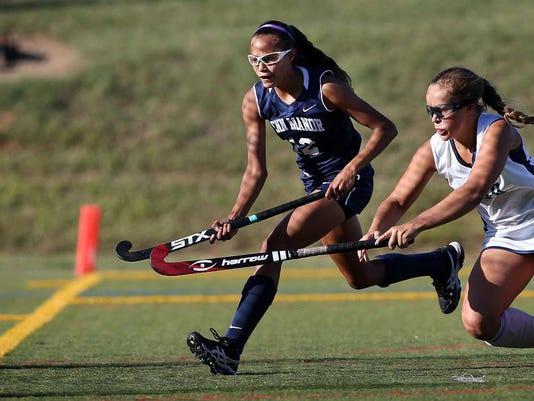 Penn Manor's Alyssa Schriver (12) scores on Manheim Twp.'s Olivia Witmer (20) during second half action at Manheim Twp. High School in Neffsville Monday September 14, 2015. Chris Knight - GametimePa.com