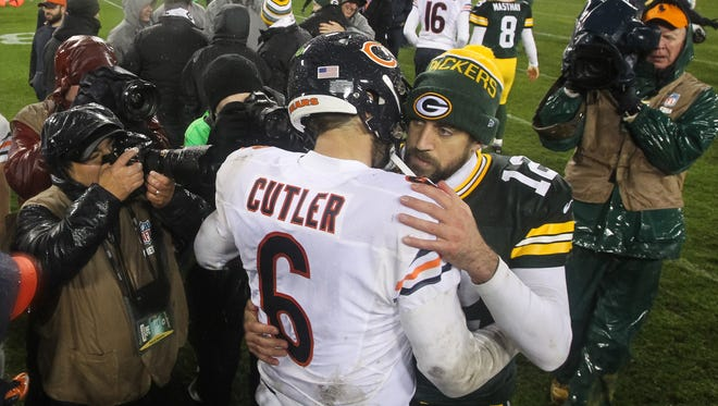 Quarterbacks Jay Cutler and  Aaron Rodgers.