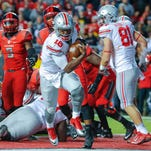 Oct 24, 2015; Piscataway, NJ, USA;  Ohio State Buckeyes quarterback J.T. Barrett (16) crosses the goal line for second quarter touchdown against the Rutgers Scarlet Knights at High Points Solutions Stadium. Mandatory Credit: Jim O'Connor-USA TODAY Sports