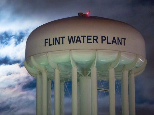 The City of Flint Water Plant is illuminated by moonlight