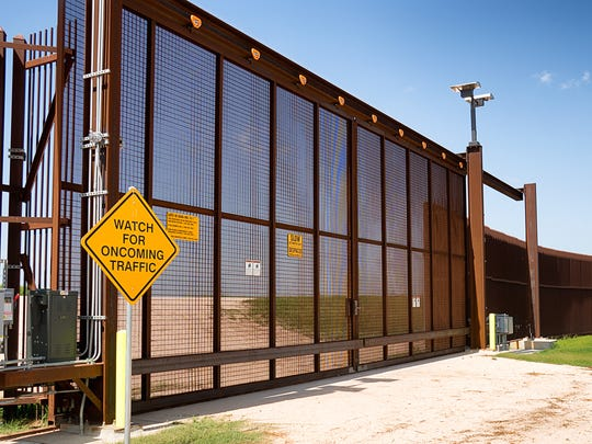 The fence marking the border between Mexico and the United States is photographed on July 16 in La Paloma,Texas.