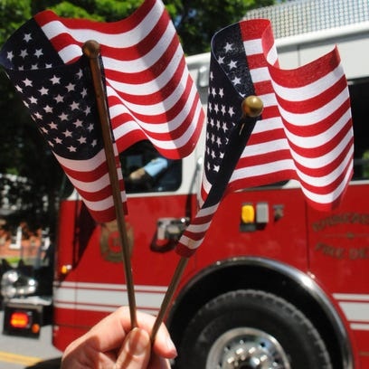 Flags wave during the Memorial Day parade in Rhinebeck in 2013.