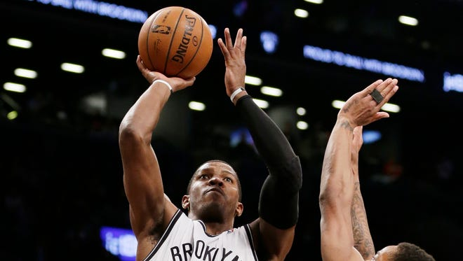 Brooklyn's Joe Johnson, left, shoots over Toronto's DeMar DeRozan in the second half on Friday. The Nets could take a 3-1 series lead with a win Sunday.