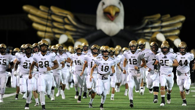 Abilene High players take the field before the Eagles' game against Keller Timber Creek on Thursday, Nov. 3, 2016, at Keller Athletic Complex.