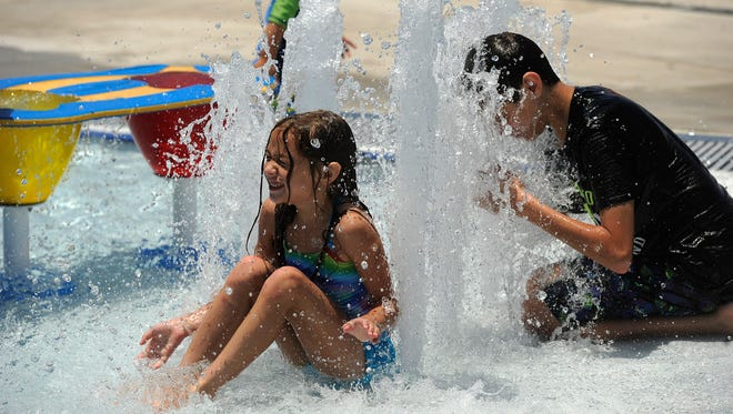 Kids play in the fountains at Adventure Cove on June 22.  The city of Abilene's aquatic park opened in June at Rose Park at the former location of the city swimming pool.