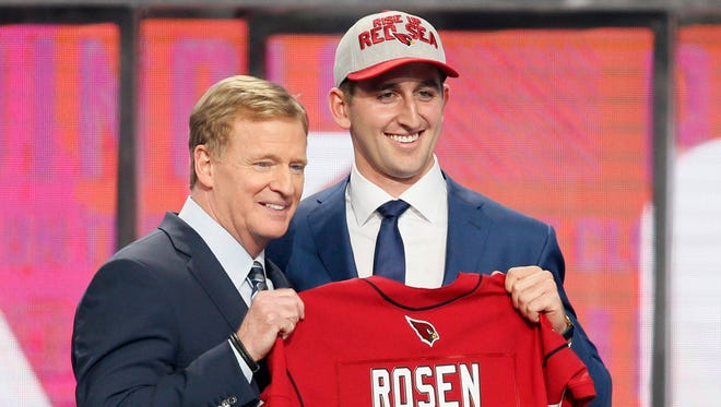 Josh Rosen (UCLA) with NFL commissioner Roger Goodell after being selected as the number ten overall pick to the Arizona Cardinals in the first round of the 2018 NFL Draft at AT&T Stadium.