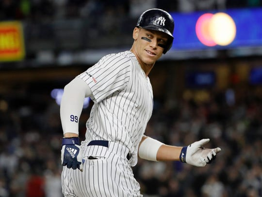 New York Yankees' Aaron Judge smiles at third base coach Phil Nevin as he runs the bases after hitting a two-run home run during the third inning of the team's baseball game against the Los Angeles Angels on Wednesday, Sept. 18, 2019, in New York. (AP Photo/Frank Franklin II)