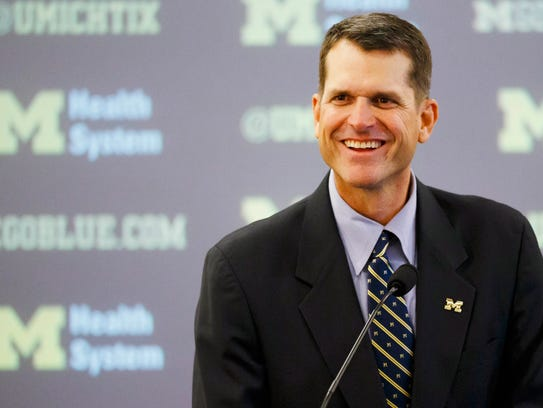 Jim Harbaugh speaks to the media as he is introduced