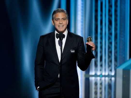 George Clooney accepts the Cecile B. Demille Award