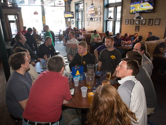 Guests watch as UNI plays Wyoming in the NCAA tournament on March 20, 2015, at Johnny's Hall of Fame in Des Moines.