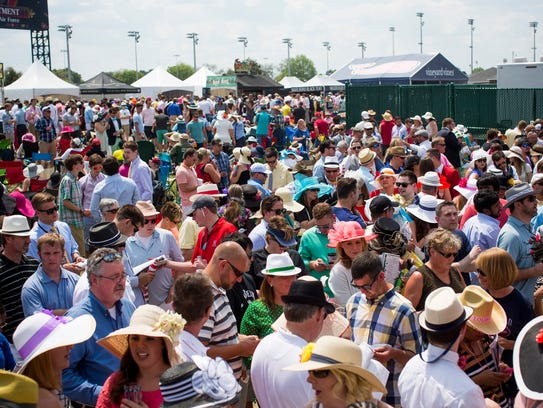 A large crowd lined up in front of one of the infield