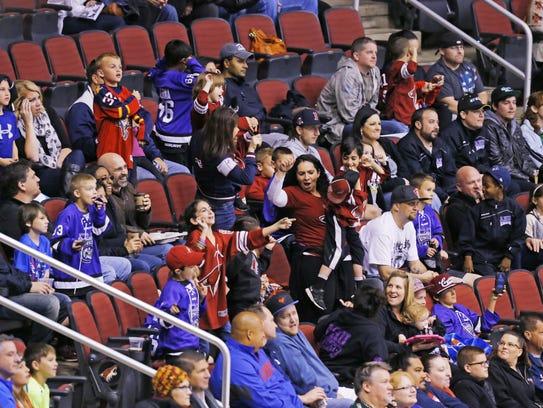 Hockey fans watch the Arizona Coyotes host the Nashville