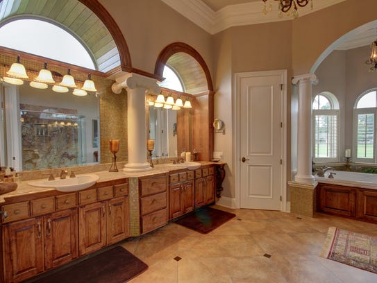 The beautiful master bath has marble throughout.