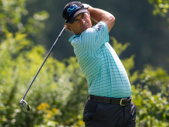 Scott McCarron watches his drive during the second