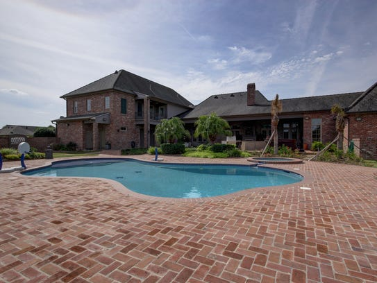 A pool, spa and brick decking  are part of the spacious
