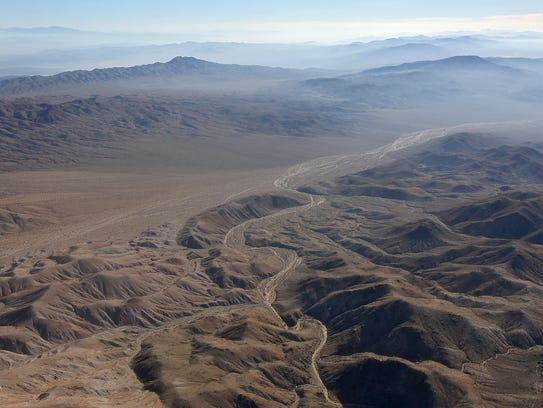 A wash can be seen snaking its way through the Mojave