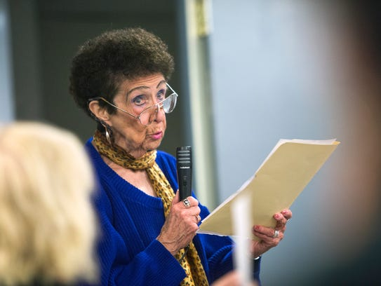 Woodburn Court resident Patricia Donohue speaks during
