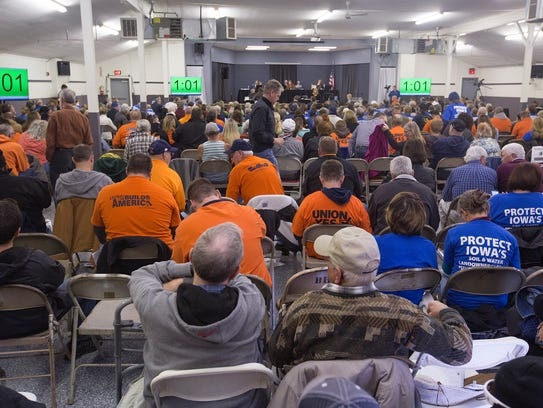 Attendees at the Iowa Utilities Board public hearings