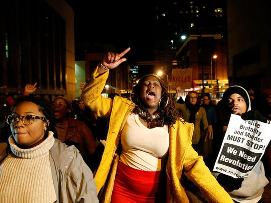 Protesters march through the streets after a mistrial