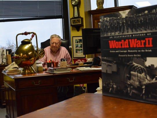 Hilliard at his desk at Badger Oil.