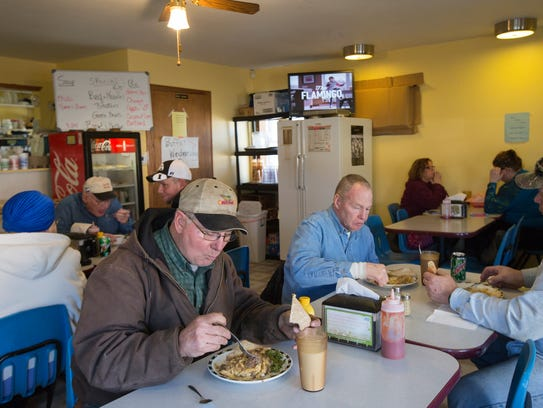 Guy Petersen eats lunch with friends at the Bear Creek
