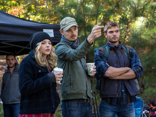 J Blakeson (center) directs a scene with Chloë Grace