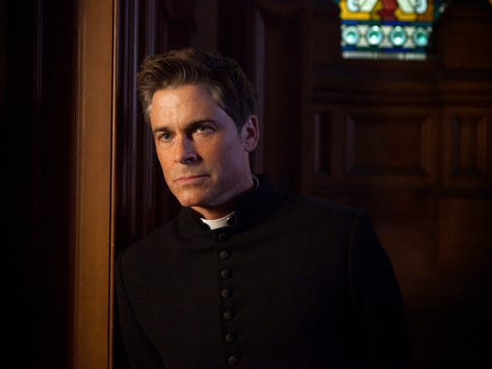 "Rob Lowe as Father Jude Sutton in ""Apocalypse."""