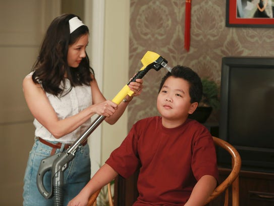 Jessica (Constance Wu) gives Eddie (Hudson Yang) a