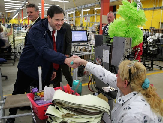 Florida Sen. Marco Rubio  greets employees of Globe