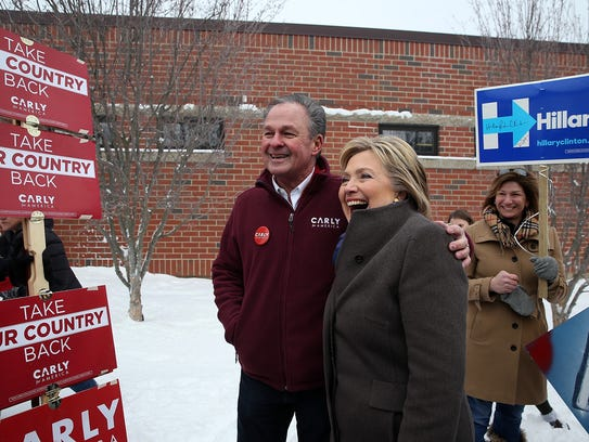 Hillary Clinton poses for a picture with Frank Fiorina