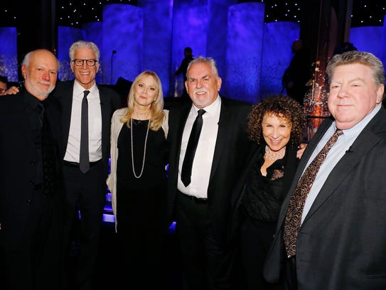 James Burrows, left, is joined by the cast of 'Cheers,'