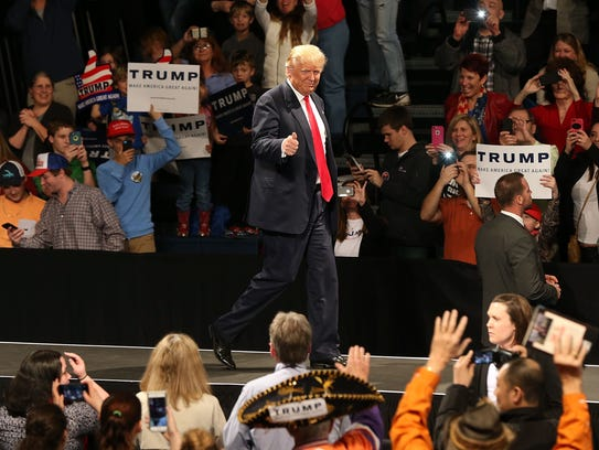 Donald Trump walks on stage on Feb. 17, 2016, in Sumter,