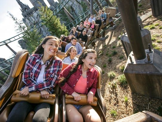 Park guests enjoy the Flight of the Hippogriff in the