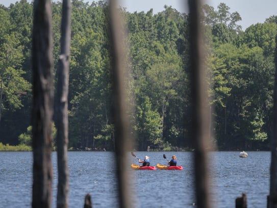 A women's kayak tour at the Manasquan Reservoir in