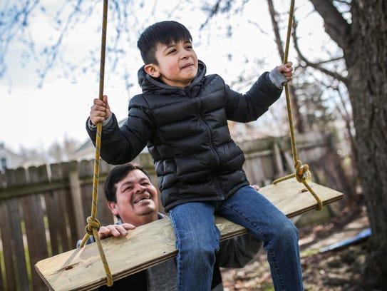 Salvador Calderon, 44, of Lorain, OH, plays with his